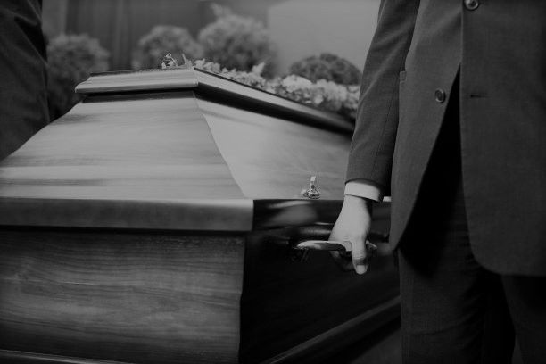 man carrying a casket